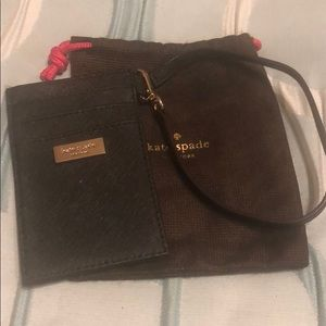 Kate Spade black card/ID holder with wrist strap.